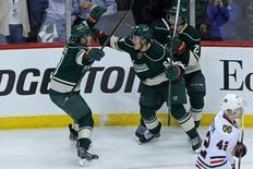 May 6, 2014; Saint Paul, MN, USA; Minnesota Wild forward Mikael Granlund (64) celebrates his goal with forward Zach Parise (11) and defenseman Jonas Brodin (25) during the third period against the Chicago Blackhawks in game three of the second round of the 2014 Stanley Cup Playoffs at Xcel Energy Center.  Brace Hemmelgarn-USA TODAY Sports