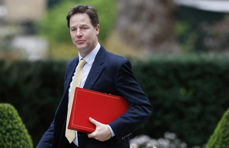 Deputy Prime Minister Nick Clegg arrives for a cabinet meeting at 10 Downing Street in central London March 19, 2014.  REUTERS/Suzanne Plunkett