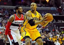 May 9, 2014; Washington, DC, USA; Indiana Pacers power forward David West (21) looks to pass as Washington Wizards point guard John Wall (2) defends during the first half in game three of the second round of the 2014 NBA Playoffs at Verizon Center. Mandatory Credit: Brad Mills-USA TODAY Sports