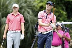 May 11, 2014; Ponte Vedra Beach, FL, USA; Martin Kaymer and Jordan Spieth watch Kaymer drive on the 2nd hole during the final round of The Players Championship at TPC Sawgrass - Stadium Course. Geoff Burke-USA TODAY Sports