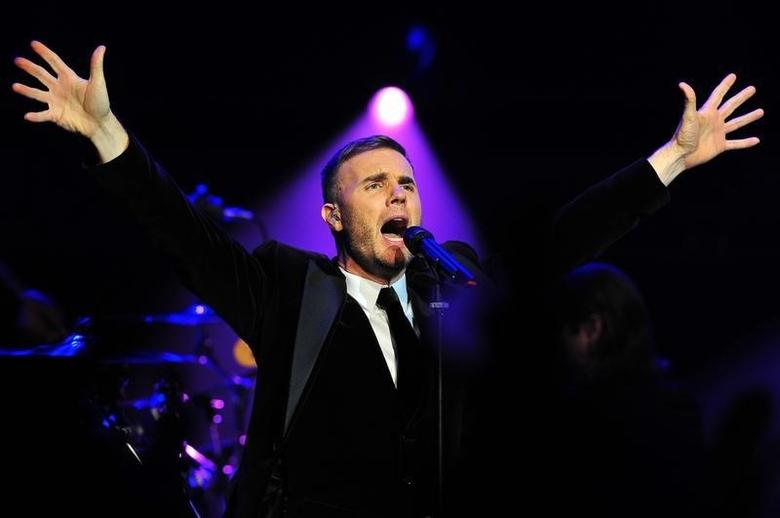 Singer Gary Barlow performs at a fund-raising concert in front of royalty at the Royal Albert Hall in London December 6, 2011. REUTERS/Ben Stansall/POOL