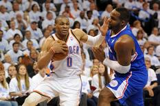 May 13, 2014; Oklahoma City, OK, USA; Oklahoma City Thunder guard Russell Westbrook (0) handles the ball against Los Angeles Clippers forward Glen Davis (0) during the fourth quarter in game five of the second round of the 2014 NBA Playoffs at Chesapeake Energy Arena. Mandatory Credit: Mark D. Smith-USA TODAY Sports