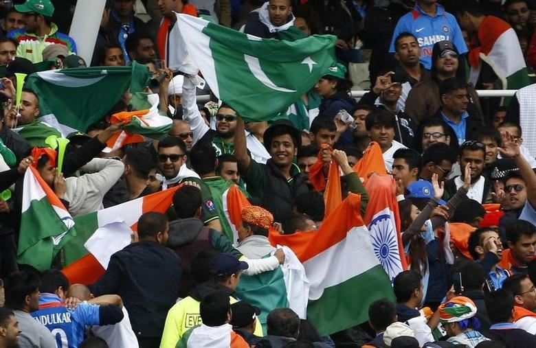 India and Pakistan fans fly flags during a rain break in their ICC Champions Trophy group B match at Edgbaston cricket ground in Birmingham, central England, June 15, 2013. REUTERS/Darren Staples/Files