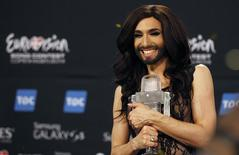 Austrian drag queen Conchita Wurst poses with the trophy after winning the 59th annual Eurovision Song Contest at the B&W Hallerne in Copenhagen May 11, 2014. REUTERS/Tobias Schwarz