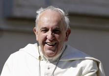 Pope Francis smiles as he arrives to lead his Wednesday general audience in Saint Peter's Square at the Vatican May 14, 2014.   REUTERS/Max Rossi