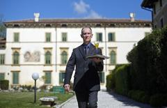 Maurizio Tagliavia walks with a drink at the Villa Del Quar, near Verona April 15, 2014. REUTERS/Max Rossi