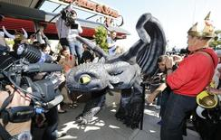 """A figure of Toothless the Dragon character walks on the Croisette during a photocall for the film """"How to Train Your Dragon 2"""" at the 67th Cannes Film Festival in Cannes May 15, 2014.  REUTERS/Regis Duvignau"""