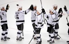 May 16, 2014; Anaheim, CA, USA; Los Angeles Kings players celebrate after defeating the Anaheim Ducks in game seven of the second round of the 2014 Stanley Cup Playoffs at Honda Center. Mandatory Credit: Robert Hanashiro-USA TODAY Sports
