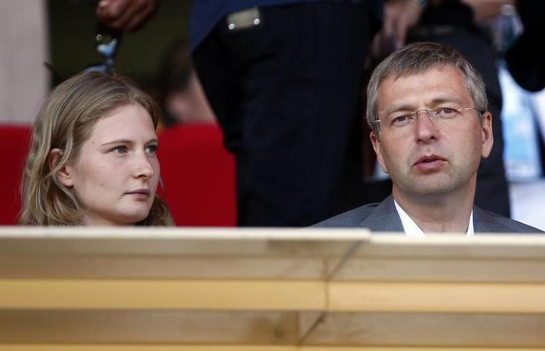 AS Monaco's President Dmitri Rybolovlev (R) and his daughter Ekaterina Rybolovleva attend the French Ligue 1 soccer match  between AS Monaco and Lorient at Louis II stadium in Monaco September 15, 2013.   REUTERS/Eric Gaillard