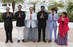 """(L-R) Cast members Lalit Behl, Ranvir Shorey, Dibakar Banerjee, Indian director Kanu Behl, Shashank Arora and producer Guneet Monga pose during a photocall for the film """"Titli""""  in competition for the category """"Un Certain Regard"""" at the 67th Cannes Film Festival in Cannes May 19, 2014.  REUTERS/Yves Herman"""