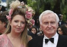 """Director John Boorman and an unidentified guest arrive on the red carpet for the film """"Vous n'Avez Encore Rien Vu"""" in competition at the 65th Cannes Film Festival, May 21, 2012.  REUTERS/Vincent Kessler"""
