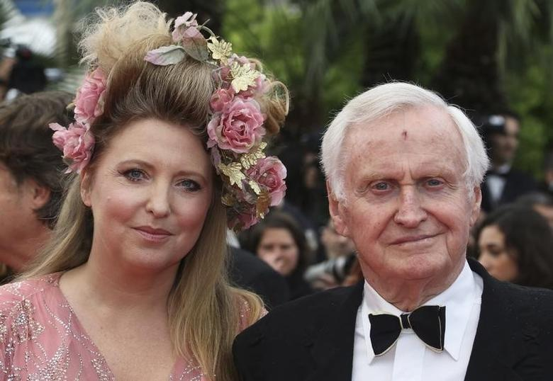 Director John Boorman and an unidentified guest arrive on the red carpet for the film ''Vous n'Avez Encore Rien Vu'' in competition at the 65th Cannes Film Festival, May 21, 2012.  REUTERS/Vincent Kessler