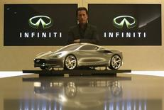Infiniti chief designer Alfonso Albaisa poses for a picture with a quarter size model of the Infiniti Emerg E car after an interview with Reuters at Nissan Technical Center in Atsugi, south of Tokyo May 20, 2014. REUTERS/Yuya Shino