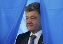 Украинский бизнесмен и политик Пётр Порошенко на избирательном участке в Киеве 25 мая 2014 года.  Порошенко выиграл президентские выборы уже в первом туре, впервые в истории современной Украины. REUTERS/Gleb Garanich