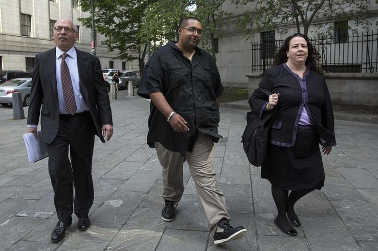 Hector Xaviar Monsegur (C), the notorious hacker known as Sabu, arrives for sentencing at the Manhattan Federal Courthouse in New York May 27, 2014.     REUTERS/Brendan McDermid