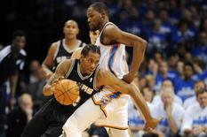 May 27, 2014; Oklahoma City, OK, USA; San Antonio Spurs forward Kawhi Leonard (2) handles the ball against Oklahoma City Thunder forward Kevin Durant (35) during the second quarter in game four of the Western Conference Finals of the 2014 NBA Playoffs at Chesapeake Energy Arena. Mandatory Credit: Mark D. Smith-USA TODAY Sports