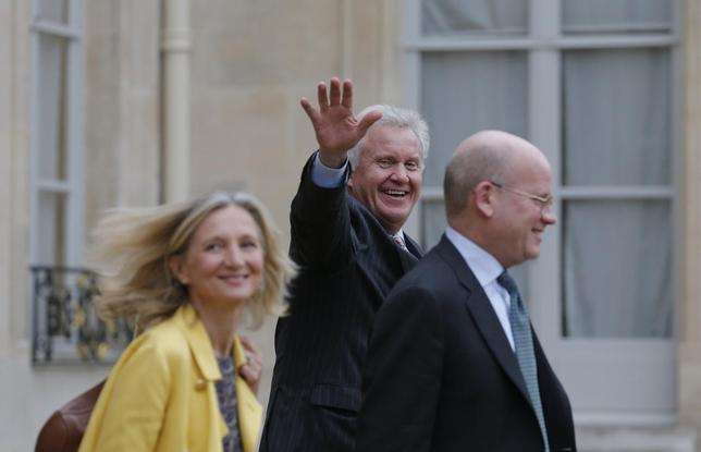 General Electric Chairman and CEO Jeffrey Immelt (C), Senior Vice President for Corporate Business Development John Flannery and Clara Gaymard (L), the head of GE France, leave after a meeting with French President to discuss the future of French engineering group Alstom at the Elysee Palace in Paris, May 28, 2014.   REUTERS/Christian Hartmann