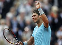 Rafael Nadal of Spain celebrates after winning his men's singles match against Dominic Thiem of Austria at the French Open tennis tournament at the Roland Garros stadium in Paris May 29, 2014.      REUTERS/Jean-Paul Pelissier