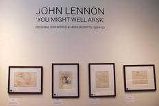 Drawings are seen as part of John Lennon's original drawings and manuscripts from 1964-65 at Sotheby's auction house in New York May 29, 2014. REUTERS/Shannon Stapleton