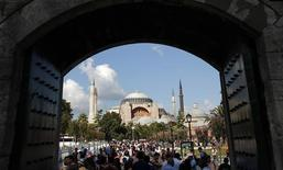 Local and foreign visitors, with the Byzantine-era monument of Hagia Sophia in the background, stroll at Sultanahmet square in Istanbul August 23, 2013. REUTERS/Murad Sezer