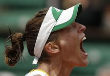 Andrea Petkovic of Germany reacts after winning her women's singles match against Kiki Bertens of the Netherlands at the French Open tennis tournament at the Roland Garros stadium in Paris June 2, 2014.      REUTERS/Jean-Paul Pelissier