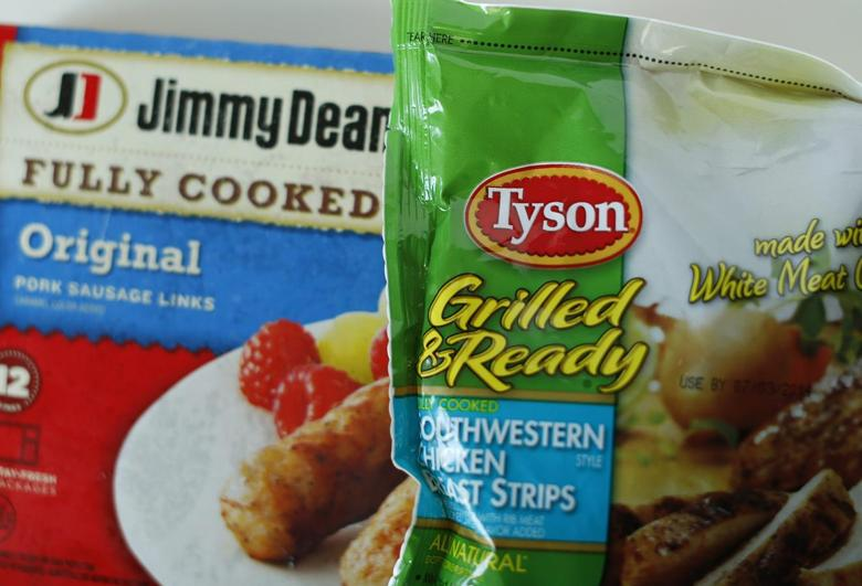Tyson foods Inc and Hillshire Brands Jimmy Dean sausages are shown in this photo illustration in Encinitas, California May 29,  2014. REUTERS/Mike Blake