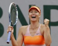 Maria Sharapova of Russia reacts after winning her women's quarter-final match against Garbine Muguruza of Spain at the French Open tennis tournament at the Roland Garros stadium in Paris June 3, 2014.       REUTERS/Gonzalo Fuentes