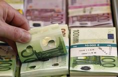 Punctured euro banknotes which are used to train sniffer dogs, are presented to the media during a news conference on German custom's annual statistics, in Berlin March 21, 2014. REUTERS/Tobias Schwarz