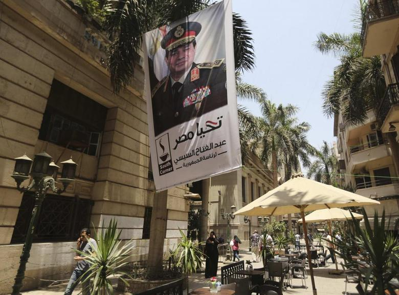 A poster of Abdel Fattah al-Sisi hangs outside the stock exchange in Cairo, May 29, 2014. REUTERS/Amr Abdallah Dalsh