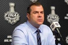 Jun 4, 2014; Los Angeles, CA, USA; New York Rangers head coach Alain Vigneault speaks at a press conference after game one of the 2014 Stanley Cup Final against the Los Angeles Kings at Staples Center. Mandatory Credit: Kirby Lee-USA TODAY Sports