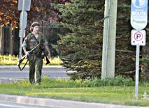 A heavily armed man that police have identified as Justin Bourque walks on Hildegard Drive in Moncton, New Brunswick June 4, 2014 after several shots were fired in the area. REUTERS/Viktor Pivovarov/Times & Transcript/telegraphjournal.com