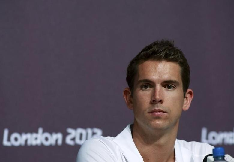 Australian swimmer Eamon Sullivan looks on during a news conference at the Media Press Centre in London 2012 Olympic Park in Stratford, east London July 23, 2012. REUTERS/Olivia Harris