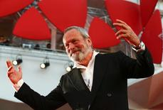 "Director Terry Gilliam gestures on the red carpet for his movie ""The Zero Theorem"" at the 70th Venice Film Festival in Venice September 2, 2013. REUTERS/Alessandro Bianchi"