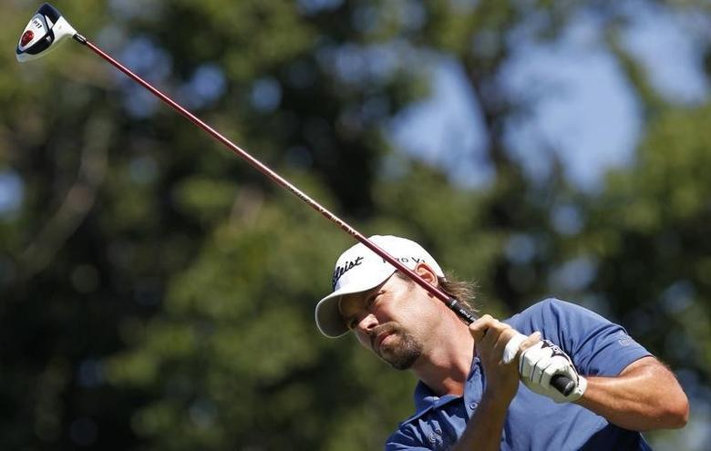 Mikael Lundberg of Sweden tees off on 12th hole during the European PGA Czech Open golf tournament in Celadna, August 21, 2011.  REUTERS/Petr Josek