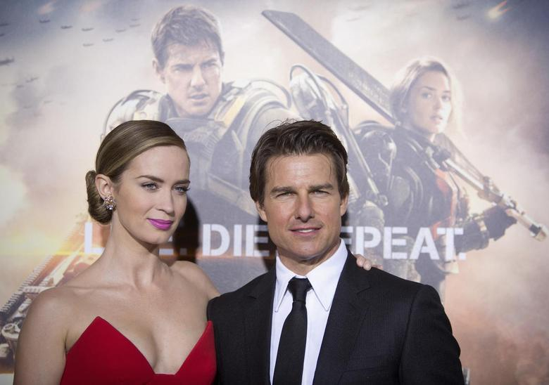 Cast members Emily Blunt and Tom Cruise arrive for the premiere of ''Edge of Tomorrow'' in New York May 28, 2014. The movie premiered in three countries in one day.    REUTERS/Carlo Allegri