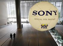 A large soccer ball-shaped installation promoting Sony Corp's partnership with FIFA is hung at Sony Corp's headquarters in Tokyo in this June 19, 2009 file photo. REUTERS/Kim Kyung-Hoon/File