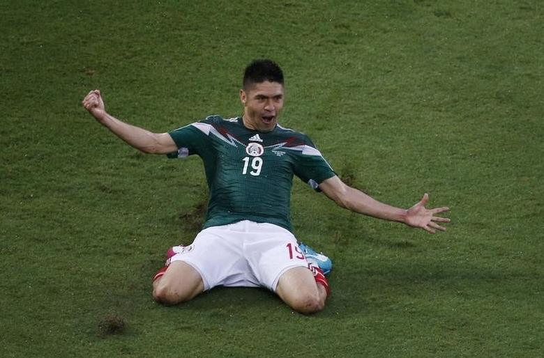 Mexico's Oribe Peralta celebrates after scoring a goal during their 2014 World Cup Group A match against Cameroon at Dunas arena in Natal June 13, 2014.  REUTERS/Carlos Barria