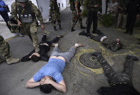 Ukraine reclaims port city from rebels