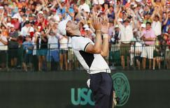 Martin Kaymer of Germany reacts after sinking his putt on the 18th green during the final round of the U.S. Open Championship golf tournament in Pinehurst, North Carolina, June 15, 2014.  REUTERS/Mike Segar