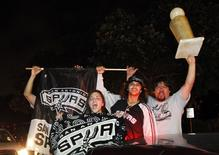 San Antonio Spurs fans celebrate after the Spurs beat the Miami Heat to win their fifth NBA Championship, in San Antonio, Texas June 16, 2014. REUTERS/Mike Stone