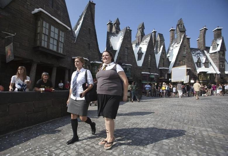 Guests tour the Wizarding World of Harry Potter theme park at the Universal Studio Resort during its grand opening in Orlando, Florida June 18, 2010. REUTERS/Scott Audette