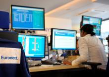 L'opérateur boursier Euronext sera introduit en Bourse (IPO) vendredi à un prix de 20 euros par action vendredi, a indiqué jeudi soir BFM TV. /Photo d'archives/REUTERS/Philippe Wojazer