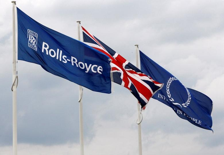 A rolls Royce flag is seen next to a Union flag in this picture taken in Derby, central England, July 20, 2010.