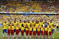 Team Brazil pose before the 2014 World Cup Group A soccer match between Brazil and Mexico at the Castelao arena in Fortaleza June 17, 2014.  REUTERS/Marcelo del Pozo