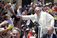Pope Francis waves to a girl as he arrives to visit the John Paul I seminary in Cassano allo Jonio, southern Italy, June 21, 2014. REUTERS/Giampiero Sposito