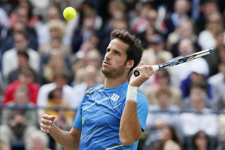 Spain's Feliciano Lopez reacts during his men's singles final tennis match against Bulgaria's Grigor Dimitrov at the Queen's Club Championships in west London June 15, 2014. REUTERS/Stefan Wermuth