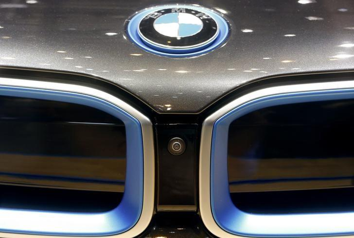 A lens of a camera system is placed between the radiator grills of a BMW 8i coupe car during the media day ahead of the 84th Geneva Motor Show at the Palexpo Arena in Geneva March 5, 2014. REUTERS/Arnd Wiegmann