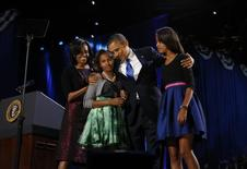 U.S. President Barack Obama celebrates with first lady Michelle Obama and their daughters Malia (R) and Sasha at their election night victory rally in Chicago, November 7, 2012.REUTERS/Kevin Lamarque