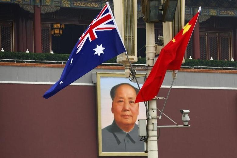 The Australian national flag flies next to the Chinese national flag in front of the giant portrait of former Chairman Mao Zedong on Tiananmen Square in Beijing, April 25, 2011. REUTERS/Petar Kujundzic
