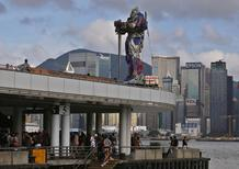 A figure of Transformer is displayed on top of a pier outside the Hong Kong Cultural Centre in Hong Kong June 18, 2014, where the world premiere of Transformers: Age of Extinction will be held on Thursday. REUTERS/Bobby Yip